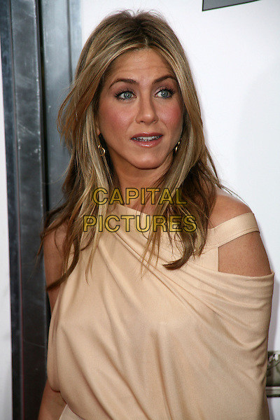JENNIFER ANISTON.At the New York City film premiere of 'The Bounty Hunter' at Ziegfeld Theatre in New York City, NY, USA, .March 16, 2010 .arrivals portrait headshot  make-up beige gold cut out off the shoulder nude surprised mouth open  .CAP/ADM/PZ.©Paul Zimmerman/Admedia/Capital Pictures