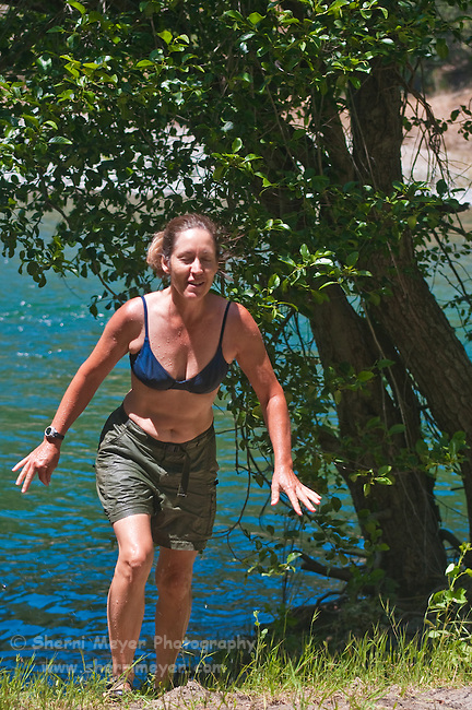 Woman heading for the sun, after a cool dip in the North Fork of the American River, Weimar, California.