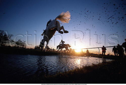 FONTWELL PARK National Hunt Horse Racing, silhouette, 9102. Photo: Mike Hewitt/Action Plus...1991.water jump.remote.national hunt.steeplechase.steeplechasing.jumps.equestrian sports