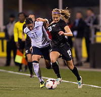 Ali Krieger (11) of the USWNT fights with Rosie White (13) of New Zealand during an international friendly at Crew Stadium in Columbus, OH. The USWNT tied New Zealand, 1-1.