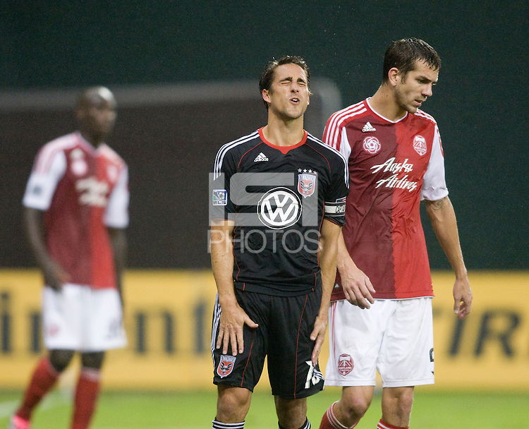 Josh Wolff (16) of D.C. United reacts to a missed shot on goal during the game at RFK Stadium in Washington, D.C. D.C. United tied the Portland Timbers, 1-1.