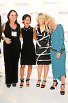 Josie Natori, Carole Hochman, Betsey Johnson, and guest at the CURVE and CFDA Party For A Cause event during the CURVENY Lingerie & Swim show, at the Jacob Javits Convention Center, August 2, 2010.