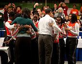 Washington, DC - January 19, 2009 -- United States President-elect Barack Obama and Michelle Obama are greeted by a group of cheer leaders at Calvin Coolidge High School where students, military families, and volunteer service groups are working on various projects supporting the troops  in Washington, D.C., U.S., Monday, January 19, 2009.  .Credit: Joshua Roberts - Pool via CNP