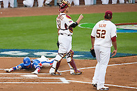 21 March 2009: #15 Yong-Kyu Lee of Korea slides safe at home on a single by #50 Hyun-Soo Kim during the 2009 World Baseball Classic semifinal game at Dodger Stadium in Los Angeles, California, USA. Korea wins 10-2 over Venezuela.
