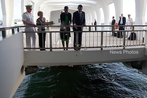 United States President Barack Obama and first lady Michelle Obama release flowers over the sunken U.S.S. Arizona at the U.S.S. Arizona Memorial on Thursday, December 29, 2011 in Pearl Harbor, Hawaii.  .Credit: Kent Nishimura / Pool via CNP