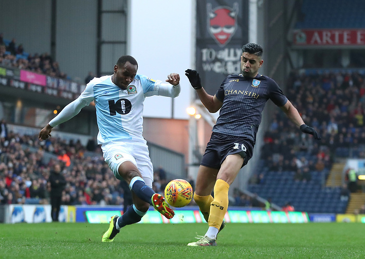 Blackburn Rovers' Ryan Nyambe and Sheffield Wednesday Marco Andre<br /> <br /> Photographer Rachel Holborn/CameraSport<br /> <br /> The EFL Sky Bet Championship - Blackburn Rovers v Sheffield Wednesday - Saturday 1st December 2018 - Ewood Park - Blackburn<br /> <br /> World Copyright &copy; 2018 CameraSport. All rights reserved. 43 Linden Ave. Countesthorpe. Leicester. England. LE8 5PG - Tel: +44 (0) 116 277 4147 - admin@camerasport.com - www.camerasport.com