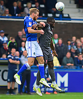 Lincoln City's John Akinde vies for possession with Macclesfield Town's Jamie Grimes<br /> <br /> Photographer Andrew Vaughan/CameraSport<br /> <br /> The EFL Sky Bet League One - Macclesfield Town v Lincoln City - Saturday 15th September 2018 - Moss Rose - Macclesfield<br /> <br /> World Copyright &copy; 2018 CameraSport. All rights reserved. 43 Linden Ave. Countesthorpe. Leicester. England. LE8 5PG - Tel: +44 (0) 116 277 4147 - admin@camerasport.com - www.camerasport.com