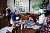 58 year old heart surgeon, Dr. Devi Prasad Shetty speaks with a family during OPD in his office at the Narayana Hrudayalaya in Bangalore, Karnataka, India. Photo: Sanjit Das/Panos