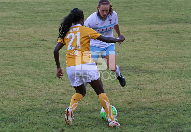 Eniola Aluko (21) of the Atlanta Beat and Whitney Engen (9) of the Chicago Red Stars. The Atlanta beat defeated the Chicago Red Stars during a Women's Professional Soccer (WPS) match at KSU Atlanta Beat Stadium Kennesaw, GA, on July 21, 2010.