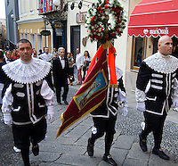 "Every year on the eve of the Feast of the Assumption, in the Candelieri festival, bands of gremi, or medieval guilds, stagger through the streets of Sassari, Sardinia, Italy, carrying 300kg 5 metre high wooden ""candlesticks"" festooned with ribbons and other decorations which they eventually leave at one of the city's churches. The procession is also joined by many others in medieval dress bearing the banners of their guilds. This is said to be in thanksgiving for the Madonna of the Assumption saving the city from an outbreak of the plague in the sixteenth century."