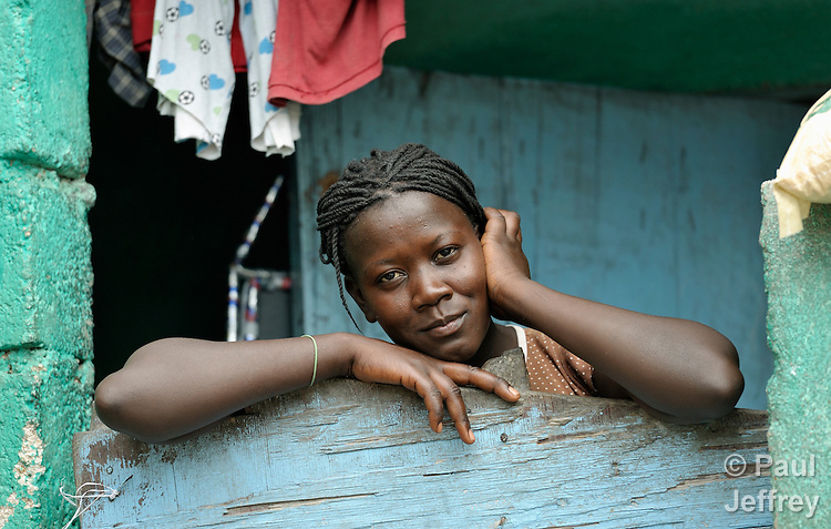 A woman living in the Bobin neighborhood of Port-au-Prince, Haiti. The January 2010 earthquake ravaged the capital, killing some 300,000 people and leaving more than 1.3 million homeless. And many people, like this woman, continue inhabiting homes that were damaged in the quake.