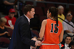 March 6, 2014; Las Vegas, NV, USA; Pepperdine Waves head coach Ryan Weisenberg (left) talks to forward Amanda Lovely (15) against the Santa Clara Broncos during the first half of the WCC Basketball Championships at Orleans Arena. The Waves defeated the Broncos 80-74.