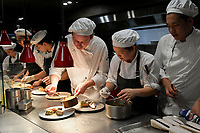 Melbourne, Australia - February 16, 2018: Chefs at work at a tribute dinner for Paul Bocuse by Chef Philippe Mouchel at Restaurant Philippe in Melbourne, Australia. Photo Sydney Low