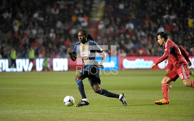 Philadelphia Union midfielder Keon Daniel (26) dribbles away from Chicago Fire midfielder Marco Pappa (16).  The Chicago Fire defeated the Philadelphia Union 1-0 at Toyota Park in Bridgeview, IL on March 24, 2012.