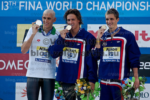 Laszlo Cseh (HUN, silver left), Ryan Lochte (USA, gold, center) and Eric Shanteau (USA, bronze, right) celebrates during the award ceremony after winning the 200 m Men's Individual Medley Swimming competition during the 13th FINA Swimming World Championships held in Rome, Italy. Thursday, 30. July 2009. ATTILA VOLGYI