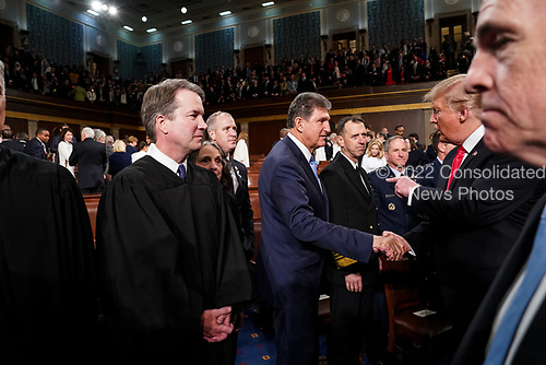 FEBRUARY 5, 2019 - WASHINGTON, DC: President Trump shook hands with Senator Joe Manchin, D-WV, next to Supreme Court Justice Brett Kavanaugh after the State of the Union at the Capitol in Washington, DC on February 5, 2019. <br /> Credit: Doug Mills / Pool, via CNP