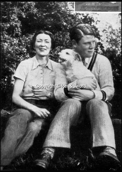 BNPS.co.uk (01202 558833)<br /> Pic: Pen&Sword/BNPS<br /> <br /> Colin with his mother and 'Jezebel', his mother's favourite terrier<br /> <br /> he remarkable story of a British hero double amputee pilot who took to the skies during the Second World War has come to light.<br /> <br /> Flight Lieutenant Colin Hodgkinson lost his legs in a horror crash in a Tiger Moth in May 1939 but went on to emulate Sir Douglas Bader and fly Spitfires in the Royal Air Force.<br /> <br /> He even endured a spell in the Great Escape prisoner of war camp after being shot down over France in 1943 but rejoined the RAF after being repatriated.<br /> <br /> The pair were the only two British double amputee pilots to fly during the war - yet while Bader, rightly, is a household name, Flt Lt Hodgkinson's exploits have been largely forgotten.<br /> <br /> This has prompted historian Mark Hillier to publish Flt Lt Hodgkinson's autobiography 60 years after it was penned which he hopes will shine some limelight on a 'special' man whose courage he says was every bit as great as Baders'.<br /> <br /> Best Foot Forward, by Colin Hodgkinson, is published by Pen & Sword.