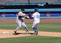25th July 2020, Los Angeles, California, USA;  Los Angeles Dodgers outfielder Mookie Betts (50) gets tagged out by San Francisco Giants infielder Pablo Sandoval (48) during the game  on July 25, 2020, at Dodger Stadium in Los Angeles, CA.