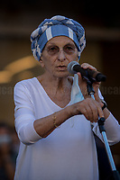 """Emma Bonino MP.<br /> <br /> Rome, 27/07/2020. Today, hundreds of people, NGO's (ONG) representatives, actors and politicians gathered in Piazza San Silvestro (near the Italian Parliament) to protest (1.) against the dramatic situation in Libya - erupted in a civil war between the GNA (2.) and the forces of General Khalifa Belqasim Haftar - and to protest against the inhumane conditions of migrant people trapped in legal and illegal prisons in Libya. The aim of the demo was to call the Italian Government to stop funding the """"Libyan Coast Guard"""" and to immediately help and free People in Libya throughout """"Humanitarian Corridors"""", and give them the protection they are entitled of by the International Human Rights Conventions. <br /> From the organisers Facebook event page: «[…] we meet to ask the Italian Government and the European States to stop funding the so-called Libyan coast guard, to close and evacuate the detention centres by transferring migrants out of Libya and to promote corridors to help people on the run find protection without endangering their lives. The men, women and children who take the sea from the Libyan coast flee from situations of extreme misery, despotic regimes, tribal persecutions, ethnic conflicts, wars and environmental catastrophes. And in Libya they are subjected to violence, extortion, detention, torture, rape and torture. A few days ago, on July 16, the Chamber of Deputies [Of the Italian Parliament, ndr] for the fourth consecutive year approved the financing of the Italian mission in Libya, which provides financial support for the so-called Libyan coastguard and training and training of its members. […] The mobilization will be accompanied by readings by Ascanio Celestini, Valentina Carnelutti, Fabrizio Gifuni and Sonia Bergamasco […]».<br /> <br /> Footnotes & Links:<br /> 1. https://www.facebook.com/events/2732849460337428/<br /> 2. 07.05.19 Prime Minister of Libya Fayez al-Serraj Met Italian PM Giuseppe Conte at Palazzo Chigi http"""