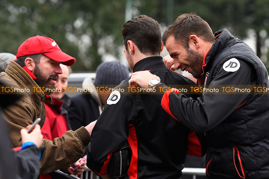 Steve Cook of AFC Bournemouth right jokes with Adam Smith of AFC Bournemouth as he signs an autograph during AFC Bournemouth vs Watford, Premier League Football at the Vitality Stadium on 21st January 2017