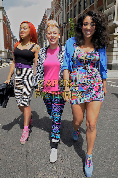 Stooshe - Karis Anderson, Courtney Rumbold, Alexandra Buggs.At BBC Radio 2 London, England..13th June 2012.full length band group black pink blue black pattern trousers jacket dress skirt striped stripes leather jacket  white walking .CAP/IA.©Ian Allis/Capital Pictures.