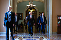 United States Senate Majority Leader Mitch McConnell (Republican of Kentucky) gives a thumbs up as he walks to his office to the United States Capitol in Washington D.C., U.S. on Wednesday, March 25, 2020.  The Senate is set to vote on a Coronavirus Stimulus Package after working late into the night on Tuesday to finalize a two trillion dollar deal.  Credit: Stefani Reynolds / CNP/AdMedia