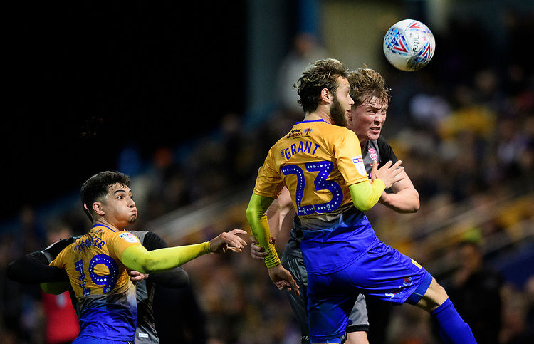 Lincoln City's Mark O'Hara vies for possession with Mansfield Town's Jorge Grant<br /> <br /> Photographer Chris Vaughan/CameraSport<br /> <br /> The EFL Sky Bet League Two - Mansfield Town v Lincoln City - Monday 18th March 2019 - Field Mill - Mansfield<br /> <br /> World Copyright © 2019 CameraSport. All rights reserved. 43 Linden Ave. Countesthorpe. Leicester. England. LE8 5PG - Tel: +44 (0) 116 277 4147 - admin@camerasport.com - www.camerasport.com