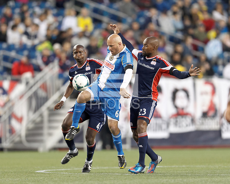Philadelphia Union forward Conor Casey (6) attempts to control the ball as New England Revolution midfielder Kalifa Cisse (4) and New England Revolution defender Jose Goncalves (23) pressure.In a Major League Soccer (MLS) match, the New England Revolution (blue/red) defeated Philadelphia Union (blue/white), 2-0, at Gillette Stadium on April 27, 2013.