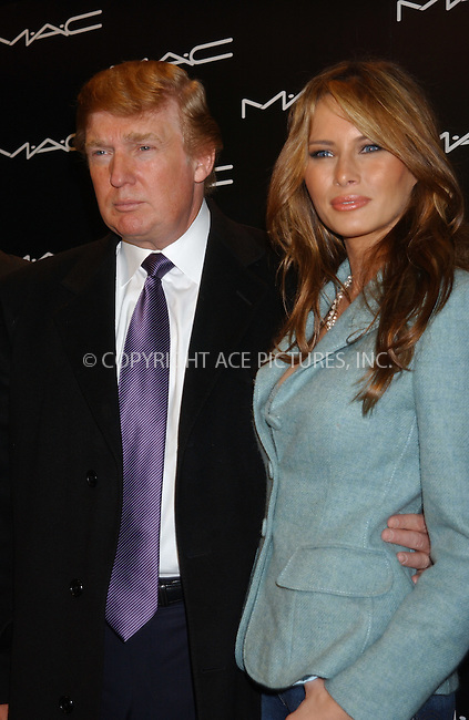 WWW.ACEPIXS.COM . . . . . ....NEW YORK, FEBRUARY 9, 2005....Donald Trump and Melania Trump pose for a photo at the annual presentation of the Mac Award, given to Melania Trump during Olympus Fashion Week at Bryant Park.....Please byline: KRISTIN CALLAHAN - ACE PICTURES.. . . . . . ..Ace Pictures, Inc:  ..Philip Vaughan (646) 769-0430..e-mail: info@acepixs.com..web: http://www.acepixs.com