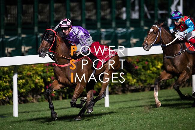 Jockey Nash Rawiller riding Who Else But You (L) during Hong Kong Racing at Happy Valley Race Course on December 06, 2017 in Hong Kong, Hong Kong. Photo by Marcio Rodrigo Machado / Power Sport Images
