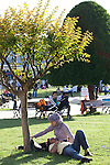 A Turkish couple relax under the shade of a tree in Sultan Ahmet Park, Istanbul...Istanbul 7 June 2012