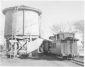 D&amp;RGW locomotive taking water at Farmington water tank with caboose #0540.<br /> D&amp;RGW  Farmington, NM  Taken by Krause, John