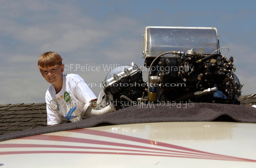 Hydros-PROP Seafair, Lake Washington, Seattle, Washington, USA 4 August,2002 .A young fan checks out the Rolls-Royce Merlin engine in the vintage championship hydroplane Miss Century 21..Copyright©F.Peirce Williams 2002..F. Peirce Williams.photography.P.O. Box 455 Eaton, OH 45320 USA.317.358.7326  fpwp@mac.com