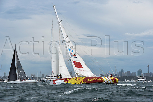 26.12.2015 Sydney, Australia. Rolex Sydney to Hobart Yacht race 2015. The rest of the fleet heads out to sea during the start of the 629 nautical mile race from Sydney to Hobart on Sydney Harbour. Qingdao from Great Britain type Clipper 70.