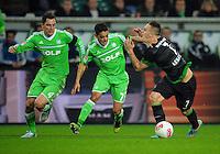 FUSSBALL   1. BUNDESLIGA    SAISON 2012/2013    13. Spieltag   VfL Wolfsburg - SV Werder Bremen                          24.11.2012 Marcel Schaefer (li) und Josue (Mitte, beide VfL Wolfsburg) gegen Marko Arnautovic (re, SV Werder Bremen)