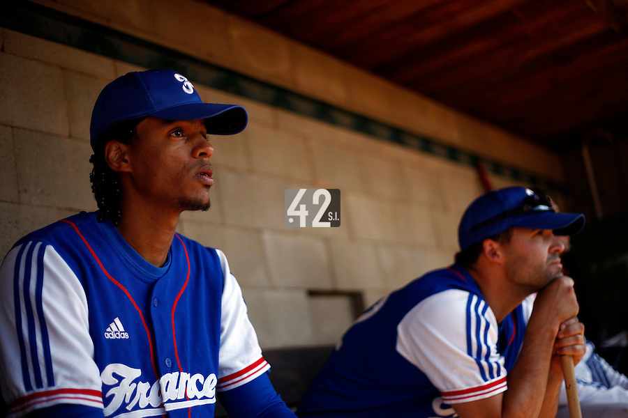 24 June 2011: Harold Castillo of Team France. Illustration of a photographic essay called Life in the dugout, during France 8-5 win over UCLA Alumni, at the 2011 Prague Baseball Week, in Prague, Czech Republic.