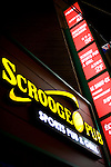 Scrooge Pub is a popular sports bar located among the chic cafes, restaurants and bars that are becoming the norm in the Itaewon entertainment district of Seoul, South Korea on 25 June 2010..Photographer: Rob Gilhooly