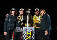 Nov 11, 2018; Pomona, CA, USA; NHRA top fuel driver Steve Torrence and mother Kay Torrence (left) pose for a portrait with funny car winner J.R. Todd and his mother as he celebrates after winning the Auto Club Finals at Auto Club Raceway. Torrence swept all six of the countdown to the championship races to clinch the world championship. Mandatory Credit: Mark J. Rebilas-USA TODAY Sports