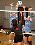 SIOUX FALLS, SD - SEPTEMBER 16: Michelle Haas #10 and McKenna Barness #13 from Lincoln try for a block on Caryn Hazard #4 from Washington in the second game of their match Tuesday night at Lincoln.  (Photo by Dave Eggen/Inertia)
