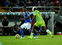 BOGOTA - COLOMBIA -17 -10-2015: Elkin Blanco (Izq.) jugador de Millonarios disputa el balón con William Palacio (Der.) jugador de Jaguares FC, durante partido entre Millonarios y Jaguares FC, por la fecha 16 de la Liga Aguila II-2015, jugado en el estadio Nemesio Camacho El Campin de la ciudad de Bogota. / Elkin Blanco (L) player of Millonarios vies for the ball with William Palacio (R) player of Jaguares FC, during a match between Millonarios and Jaguares FC, for the date 16 of the Liga Aguila II-2015 at the Nemesio Camacho El Campin Stadium in Bogota city. Photo: VizzorImage / Luis Ramirez / Staff.