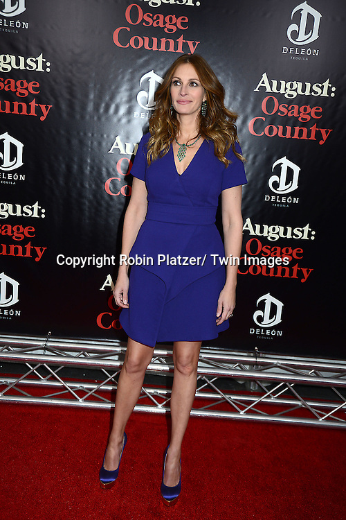 """Julia Roberts in Provenza Schoeller purple dress attends the New York Premiere of """"August: Osage County"""" on December 12, 2013 at the Ziegfeld Theatre in New York City."""