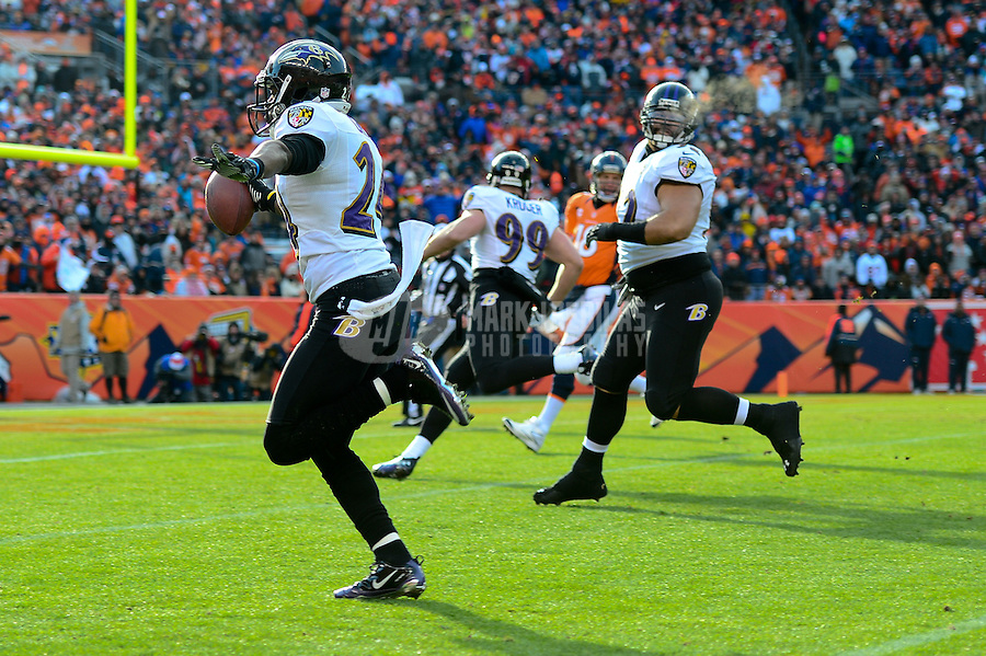 Jan 12, 2013; Denver, CO, USA; Baltimore Ravens cornerback Corey Graham (24) returns an interception for a touchdown in the first quarter against the Denver Broncos during the AFC divisional round playoff game at Sports Authority Field.  Mandatory Credit: Mark J. Rebilas-