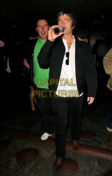 NOEL GALLAGHER .At the O2 Silver Clef Awards Lunch, Hilton Park Lane, London, England, UK, July 4th 2008..full length beer bottle drink black jacket white shirt budweiser drinking .CAP/CAN.©Can Nguyen/Capital Pictures