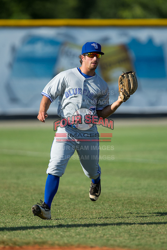 Bluefield Blue Jays left fielder Nick Sinay (6) makes a running catch in foul territory during the game against the Burlington Royals at Burlington Athletic Stadium on June 26, 2016 in Burlington, North Carolina.  The Blue Jays defeated the Royals 4-3.  (Brian Westerholt/Four Seam Images)