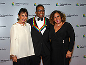 Herbie Hancock, a 2013 Kennedy Center honoree and his wife, GiGi, left, and daughter Jessica, right, arrive for the formal Artist's Dinner honoring the recipients of the 41st Annual Kennedy Center Honors hosted by United States Deputy Secretary of State John J. Sullivan at the US Department of State in Washington, D.C. on Saturday, December 1, 2018. The 2018 honorees are: singer and actress Cher; composer and pianist Philip Glass; Country music entertainer Reba McEntire; and jazz saxophonist and composer Wayne Shorter. This year, the co-creators of Hamilton, writer and actor Lin-Manuel Miranda, director Thomas Kail, choreographer Andy Blankenbuehler, and music director Alex Lacamoire will receive a unique Kennedy Center Honors as trailblazing creators of a transformative work that defies category.<br /> Credit: Ron Sachs / Pool via CNP