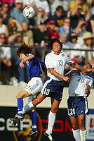Angela Hucles heads the ball during a 0-0 tie with Japan in San Diego, Calif.,  January 12, 2003.
