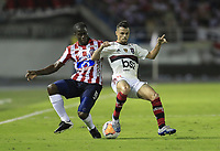 BARRANQUILLA, COLOMBIA - MARCH 04: Carmelo Valencia Chaverra of Junior fights for the ball during a group A match of Copa CONMEBOL Libertadores between Junior and Flamengo at Estadio Metropolitano on March 4, 2020 in Barranquilla, Colombia. (Photo by Daniel Munoz/VIEW press via Getty Images)