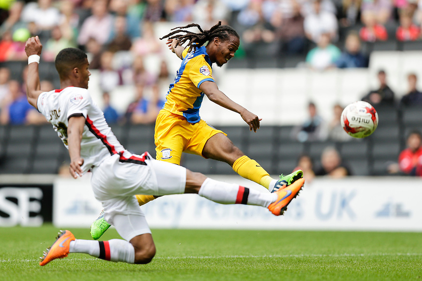 Preston North End's Daniel Johnson gets a shot in despite the attentions of Milton Keynes Dons' Jordan Spence<br /> <br /> Photographer Craig Mercer/CameraSport<br /> <br /> Football - The Football League Sky Bet Championship - Milton Keynes Dons v Preston North End - Saturday 15th August 2015 - Stadium:mk - Milton Keynes<br /> <br /> &copy; CameraSport - 43 Linden Ave. Countesthorpe. Leicester. England. LE8 5PG - Tel: +44 (0) 116 277 4147 - admin@camerasport.com - www.camerasport.com