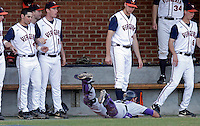 James Madison catcher Bobby San Martin (29) goes after a loose ball in the Virginia dugout during the game against James Madison University Tuesday in Charlottesville, VA.  Photo/The Daily Progress/Andrew Shurtleff