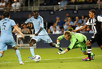 Danell Cyrus (25) Sporting KC defender clears the ball as his goalkeeper Eric Kronberg dives for the ball... Sporting Kansas City and Newcastle United played to a scoreless tie in an international friendly at LIVESTRONG Sporting Park, Kansas City, Kansas.
